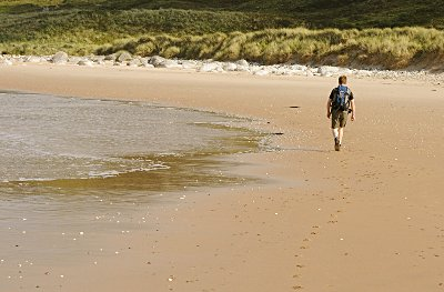 Walking along the seashore at White Park Bay